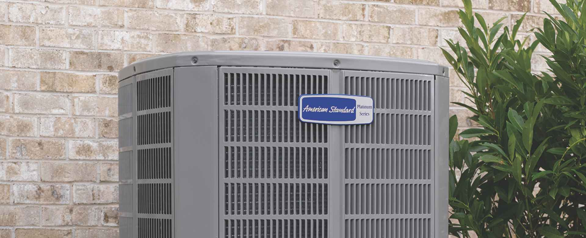 American Standard air conditioner unit in yard